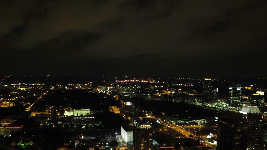 Atlanta Aerial v245 Flying through midtown at night panning during lightening storm | Shutterstock HD Video #28142350