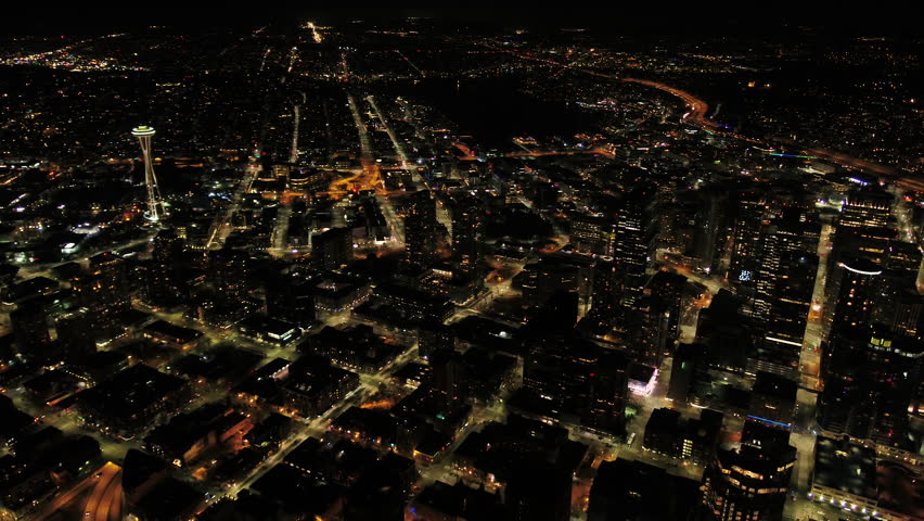 Seattle Aerial v90 Flying over downtown waterfront at night with cityscape views 4/17