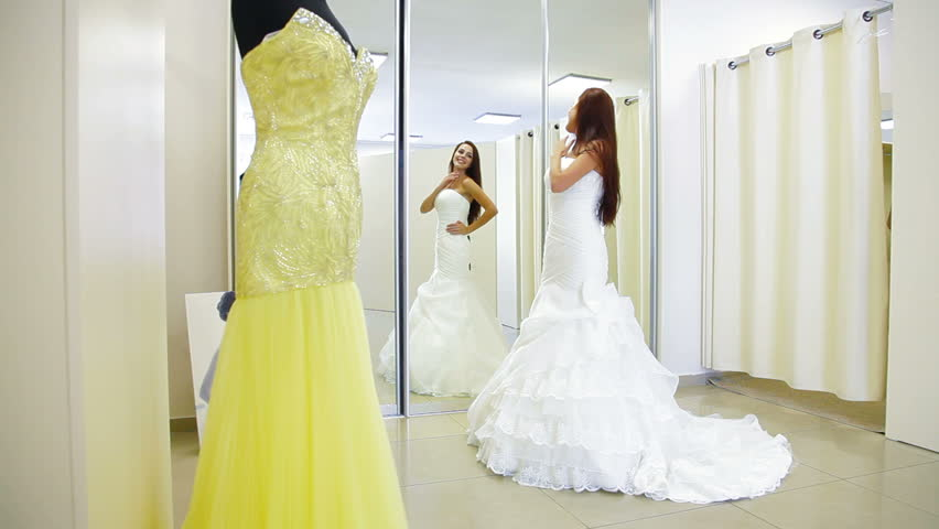 Elegant Bride Trying On Wedding Dress In Bridal Boutique Long Shot Stock Footage Video 2818378
