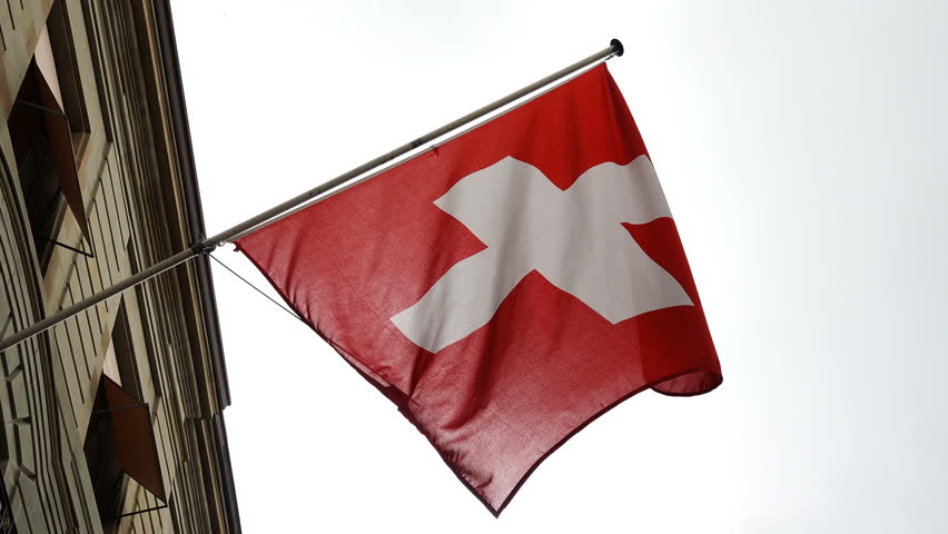 Swiss flag waves in the wind from a Building- slow motion | Shutterstock HD Video #28184047