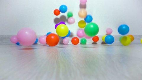 Children balls slowly fall on floor