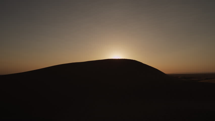 Sun over sand dunes time lapse sourced from Red Epic 5K