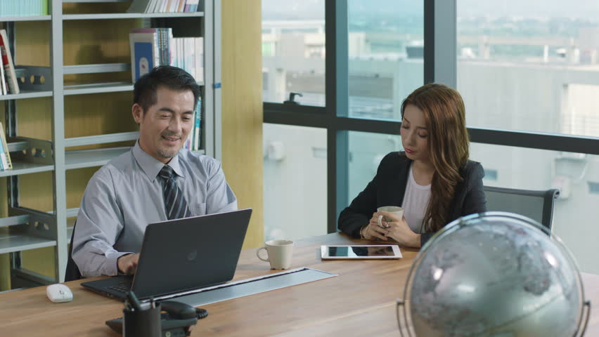 Asian business people conducting performance appraisal in office.  | Shutterstock HD Video #28269370