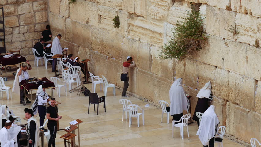 Jerusalem, Israel - May 21, 2017: Western Wall or Wailing Wall or Kotel in Jerusalem. People come to pray to the Jerusalem western wall. The Wall is the most sacred place for all jews in the world.