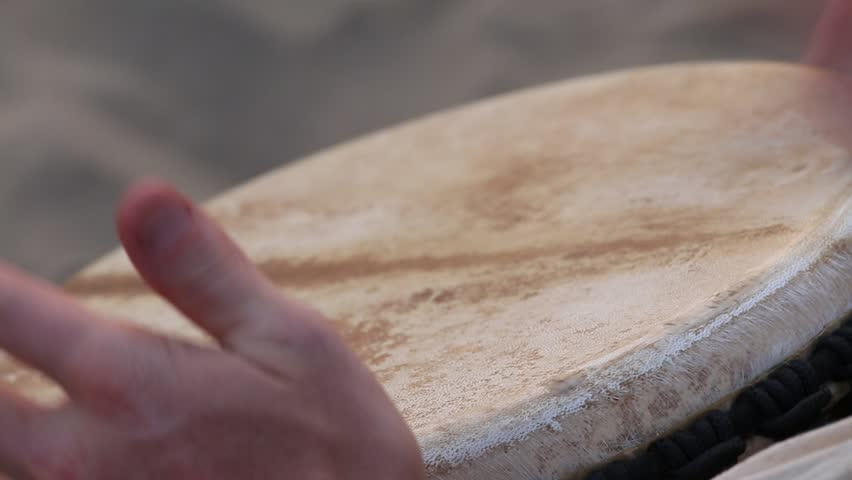Man playing on a Bongo drum close up. Hand tapping a Bongo drum in close up. Drums hands, movement, rhythm. Goa state, Arambol beach. India