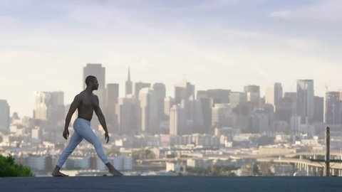 graceful ballet dancer jumping and twirling in the air in san francisco