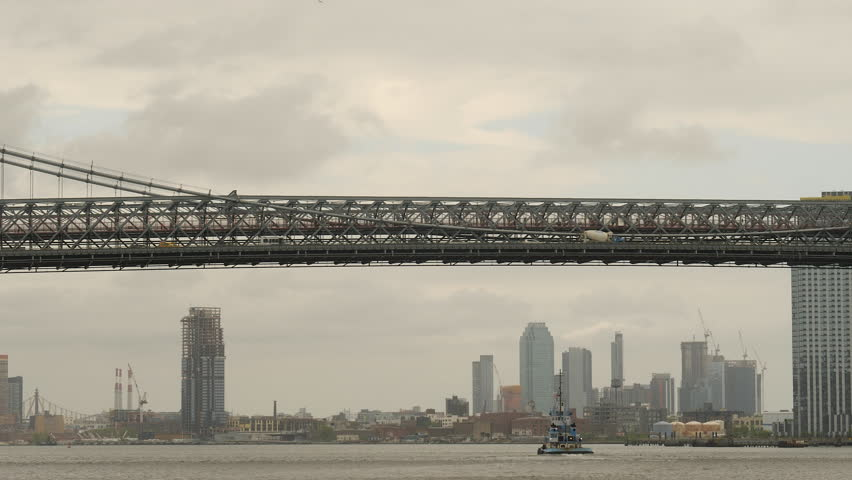 East River, towboat and bridge detail. New York City.