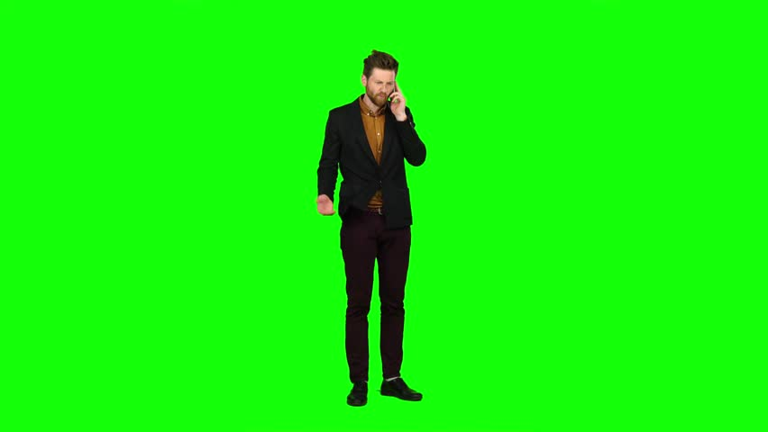 Businessman talking on the phone and nervous, shouts. Green screen   Shutterstock HD Video #28314040