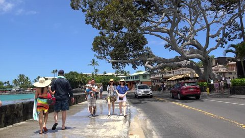 KAILUA-KONA- MAY 03 Tourists at the oceanfront downtown street of Kailua-Kona (Alii drive).  May 03, 2017 in Kailua-Kona, Big Island, Hawaii, USA
