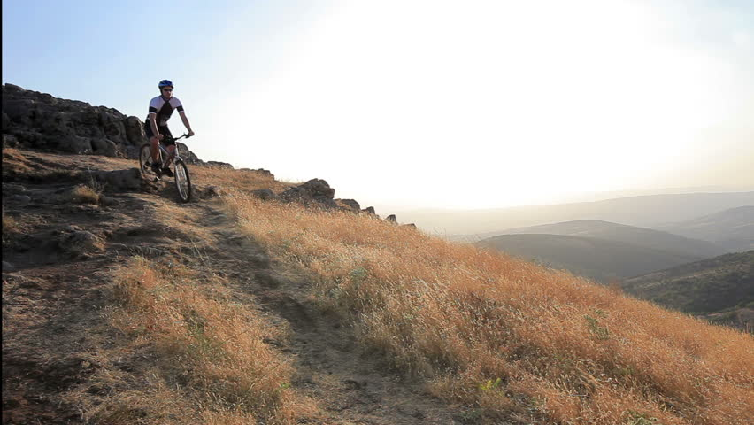 A view of a biker riding a mountain bike on a sunset, Macedonia