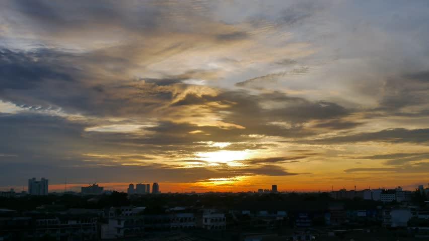 Beautiful sunrise over the Bangkok city, Thailand Timelapse. Spectacular sunrises over ominous thunderstorm on the horizon.