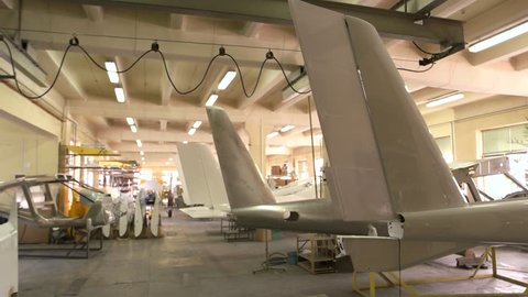 Inside aircraft workshop. Tails of airplanes. Aviation industry development.