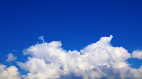 time lapse white puffy clouds in deep blue sky