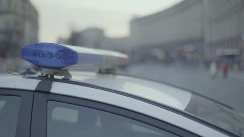Police car with flasher during the day   4K stock footage clip. Prepared Submissive And Dominance Toys On Iron Bed  Bondage And