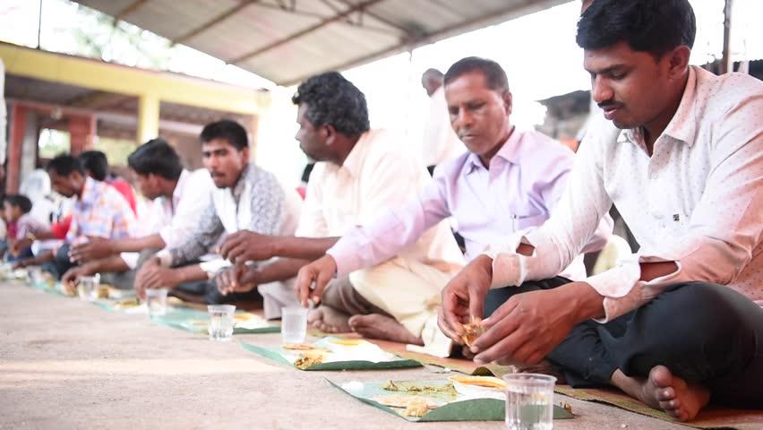 SALUNKWADI, INDIA \xD0 November 15, 2016: Community lunch in rural village Salunkwadi, Ambajogai, Beed, Maharashtra, India, South East Asia.   Shutterstock HD Video #28436950