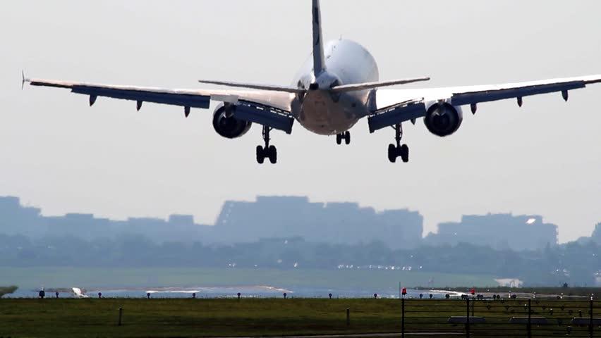 Big Airliner is landing on runway