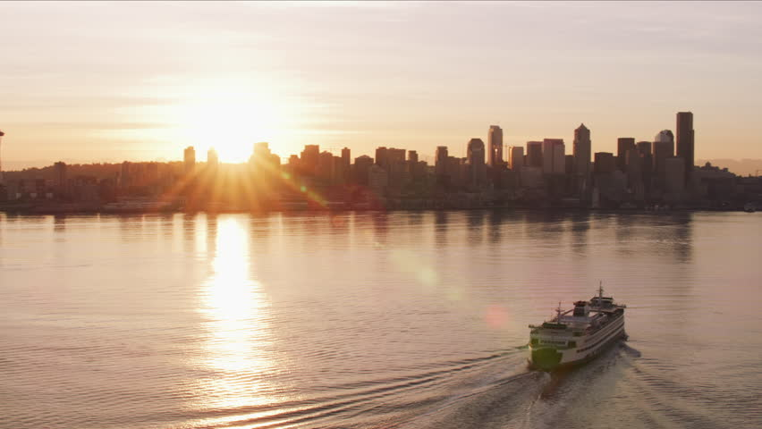 Seattle, Washington circa-2017, Ferry heading towards Seattle at sunrise. Shot with Cineflex and RED Epic-W Helium. | Shutterstock HD Video #28478140