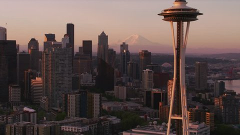 Seattle, Washington circa-2017, Aerial view of Seattle at sunrise with Space Needle and Mt. Rainier. Shot with Cineflex and RED Epic-W Helium.