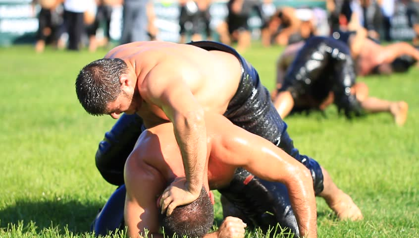 ISTANBUL - AUG 24: Unidentified wrestlers in the 8th Sile Annual Oil Wrestling Event on August 24, 2012 in Istanbul. Close up of highest ranking oil wrestlers (Pehlivan) in a tight grip.