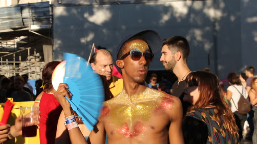 MADRID, SPAIN 01 JULY 2017: Attractive participants dancing of the World Pride festival in Madrid 2017. International people in costumes celebrates of LGBT Gay Pride Parade in Madrid 2017