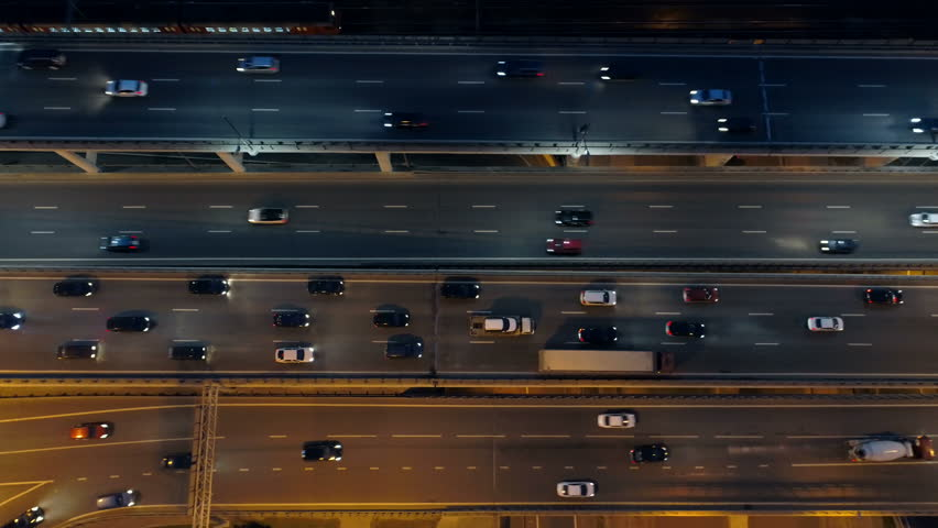 Drone footage of midnight city roads. Aerial view.