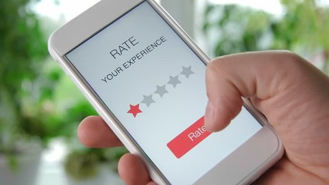 Man gives one star rating using smartphone application