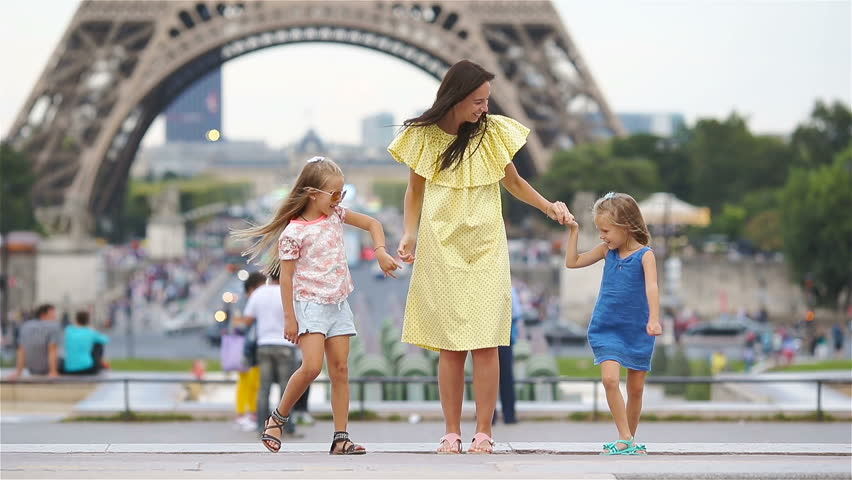 Happy family in Paris near Eiffel tower. French summer holidays, travel and people concept. | Shutterstock HD Video #28554340