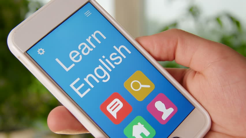Learn English concept application on the smartphone. Man uses mobile app.