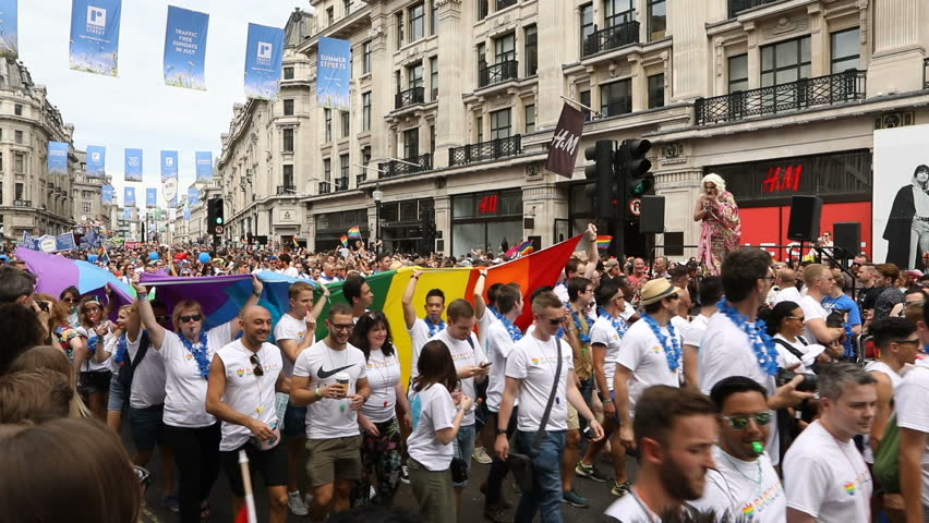 Flags and crow Pride in London Parade 2017 July 8 on Oxford Circus and Regent Street.   Series of  Reportage photo from gay parade. Video footage