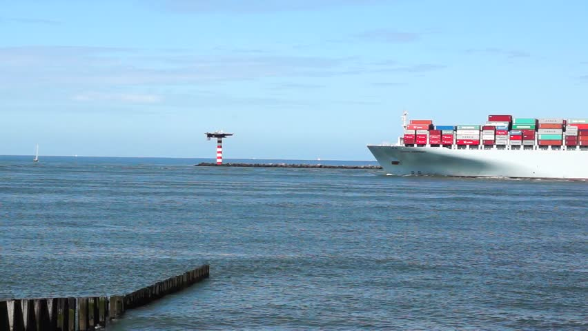 ROTTERDAM - AUGUST 2: Container Ship COSCO with full of cargo from the port of Rotterdamon on August 2, 2012. COSCO Group is the largest liner carrier in China.