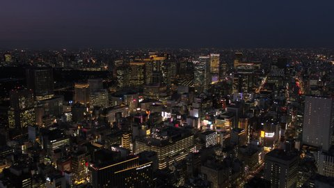Japan Tokyo Aerial v47 Flying low over downtown Chuo area with cityscape views night 2/17