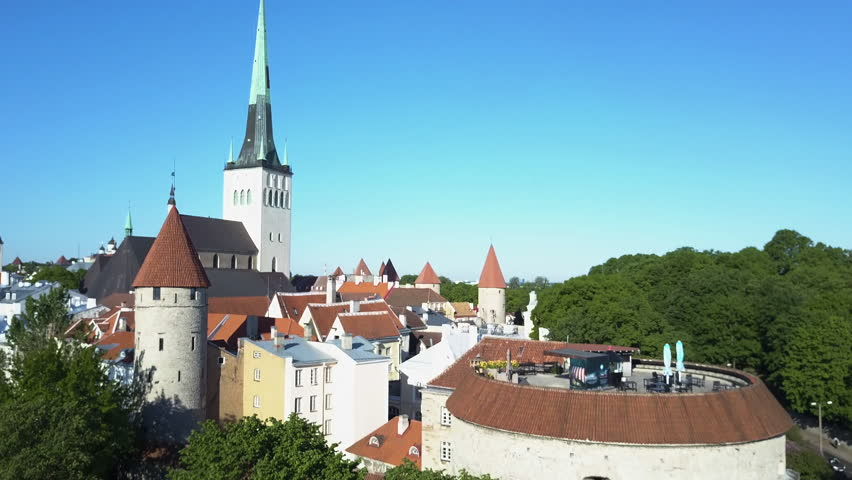 Crane shot of Fat Margaret tower and wall around Tallinn Estonia old town
