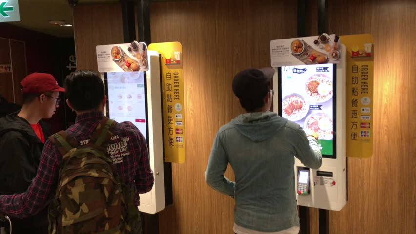 HONG KONG, - MARCH 16, 2017: People visit McCafe. McCafe is a coffee-house-style food and drink chain, owned by McDonald's. McDonald's is the world's largest chain of hamburger fast food restaurants.