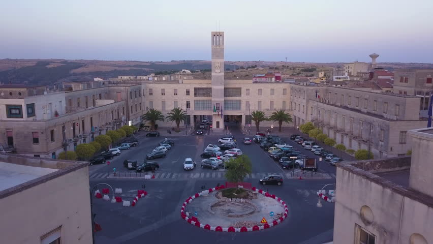 flying towards fascist symbol on Guardia di Finanza tower in Ragusa