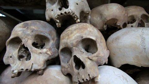 a closeup of skulls and bones in Killing field, cambodia