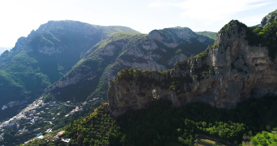 flying above Montepertuso Hole in Mountain near Poistano in Italy #28661470