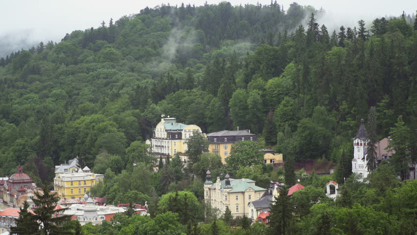 Marienbad. Marianske  Lazne CZ Typical Buildings and Water cycle -  fog drip sublimination Effects on climate Evaporation in Forest   The transformation of water  into the overlying atmosphere. | Shutterstock HD Video #28663600