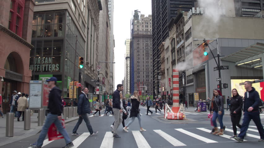 New York, Usa, 05.05.2017. The street of New York. Pedestrian crossings, smoking pipe, skyscrapers in Manhattan. Steadycam shot