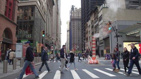New York, Usa, 05.05.2017. The street of New York. Pedestrian crossings, smoking pipe, skyscrapers in Manhattan. Steadycam shot