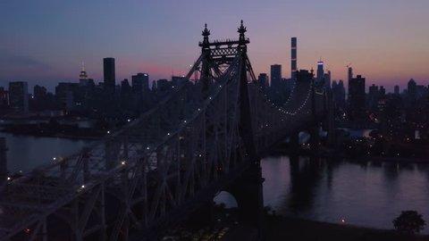 dusk counter clockwise orbiting Queensboro Bridge