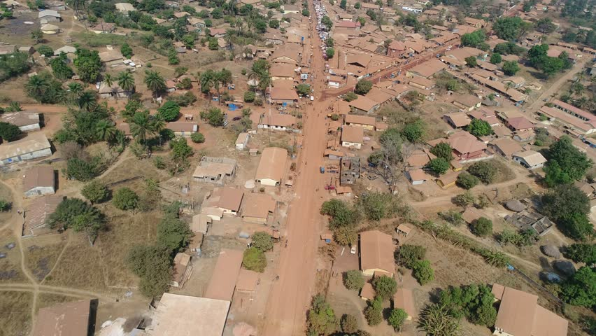 Drone view over the poor township Télimélé in Guinea, West Africa - aerial over the road and dry landscape