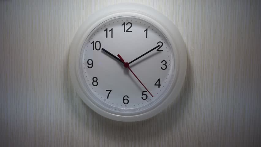 Clock Ticking On The Wallpapered Wall   HD Stock Video Clip