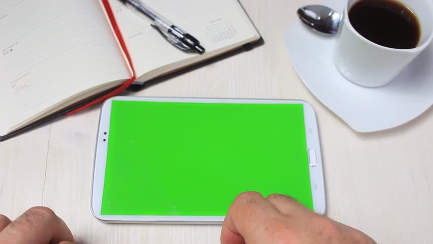 Businessman using a modern smartphone with green screen at his desk. Chroma key - green screen for placement of your own content | Shutterstock HD Video #28707490