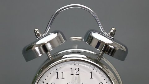 Tempus Fugit no.5 Alarm clock rings continuously, starting just before 12 o'clock.