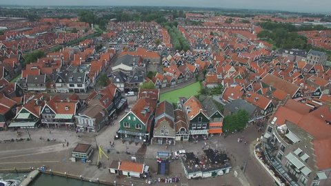Aerial over harbour lined with historical houses,Volendam,Netherlands
