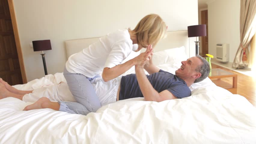 Romantic Husband Bringing His Wife Breakfast In Bed At