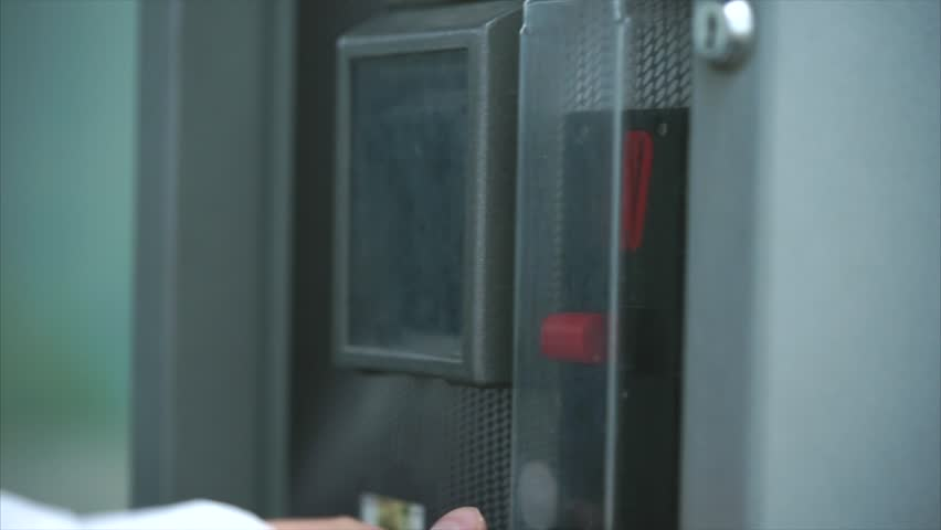Man dropping coin into vending machine, paying for something. Put money into a slot. Financial operation. Close up view | Shutterstock HD Video #28741570