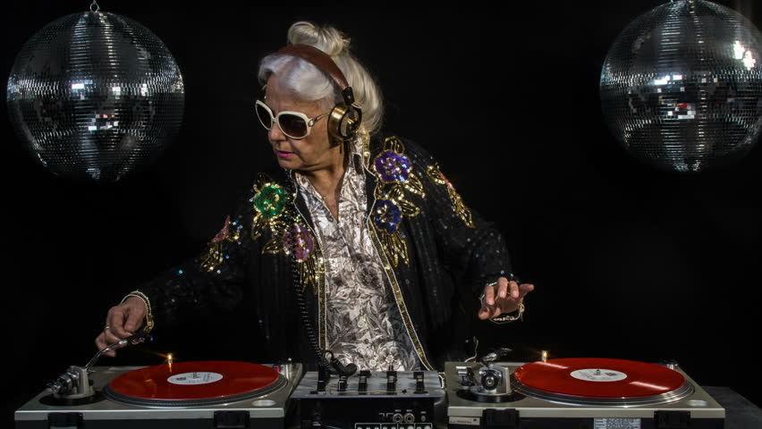 amazing DJ grandma, older lady djing and partying in a disco setting. these retired rockers will get the party going