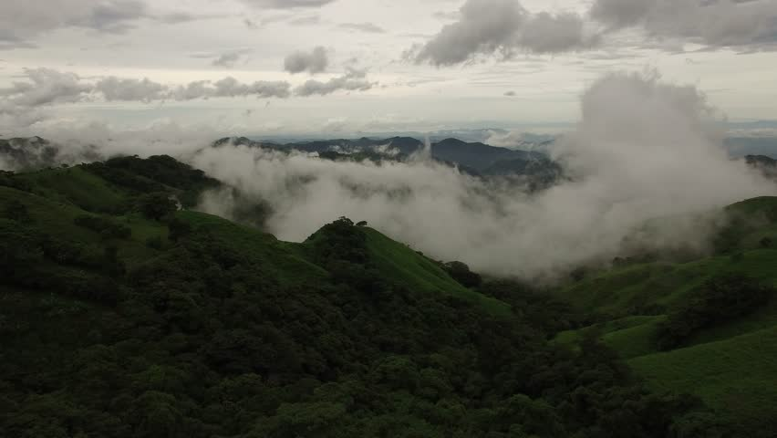 4K aerial of the rural, mountainous countryside of Costa Rica, in the rainforest of tropical latin America, Puntarenas Province