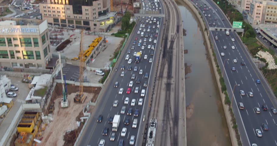 Tel Aviv - 01 January 2017: Tel Aviv road traffic and train moving, aerial footage 4k | Shutterstock HD Video #28841440